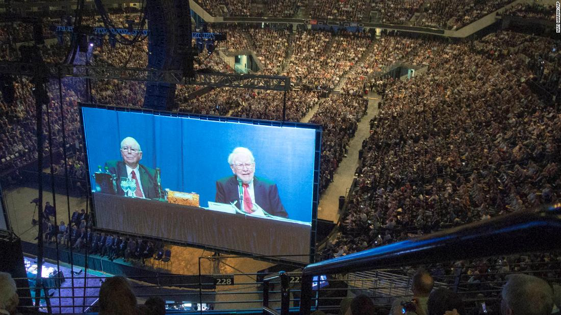 Buffett and Berkshire Hathaway Vice Chairman Charlie Munger are seen on a giant screen during the Berkshire Hathaway shareholders meeting in 2013.