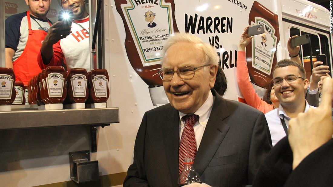 Buffett introduces products to shareholders before their annual meeting in 2014.