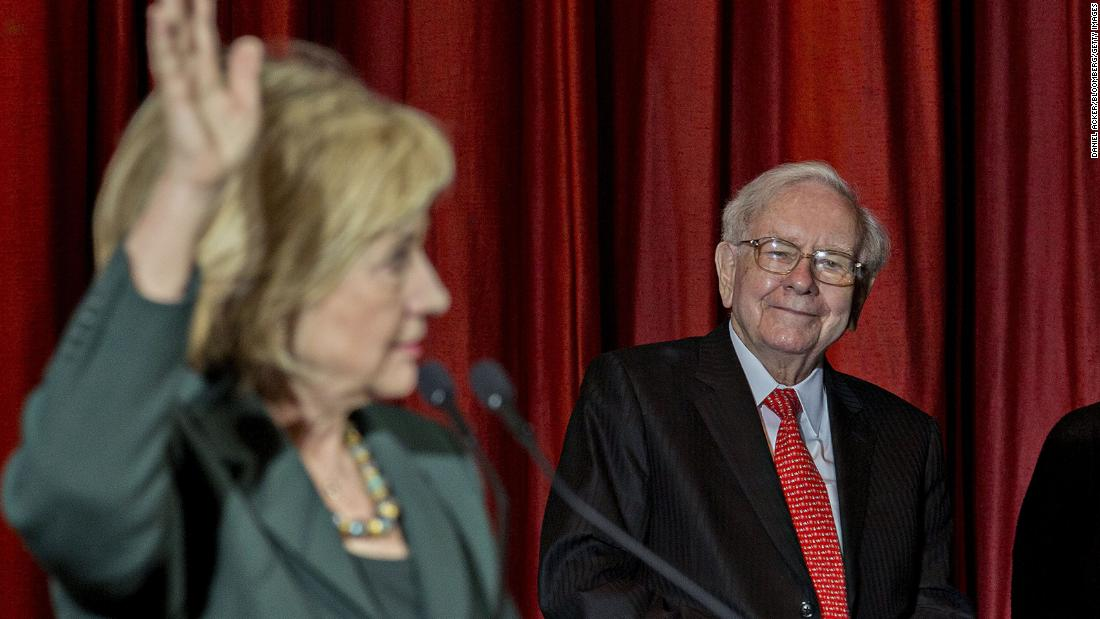 Buffett listens as presidential candidate Hillary Clinton speaks during an event in Omaha in 2015. Buffett said at the rally that he was supporting Clinton's bid for president because they share a commitment to help the less affluent.