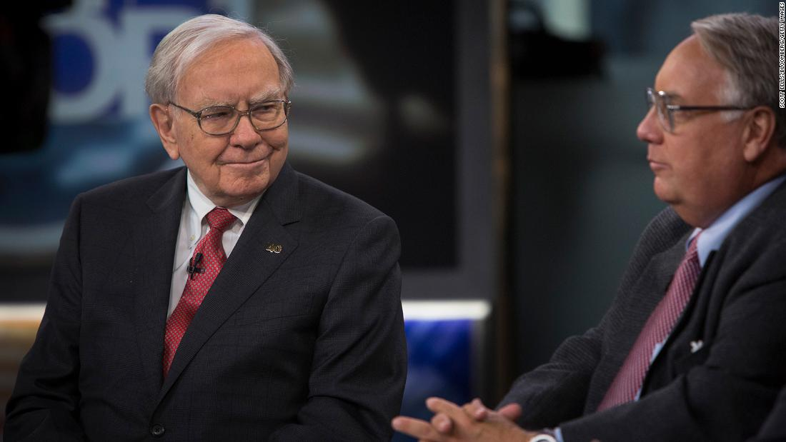 Buffett listens as his son Howard speaks during an interview in New York in 2013. Buffett and his late first wife, Susan, gave and pledged billions to each of their three children to fund charitable foundations. Howard, an Illinois farmer, picked global hunger as his target.