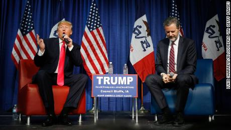 Then-candidate Donald Trump speaks on stage with Jerry Falwell Jr. during a campaign rally in Council Bluffs, Iowa, in January 2016.