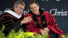 Former Florida governor Jeb Bush, then running for president, speaks with Falwell Jr. at Liberty's 2015 commencement. The school has been a frequent speaking stop for many conservative politicians.