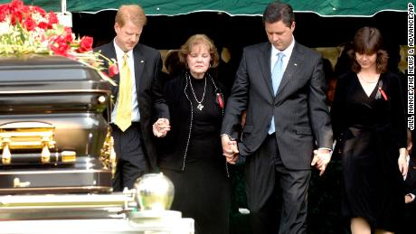 Members of the Falwell family -- from left, son Jonathan Falwell, wife Macel Falwell, son Jerry Falwell Jr. and daughter Jeannie Falwell Savas -- at the May 2007 funeral of the Rev. Jerry Falwell in Lynchburg, Virginia.
