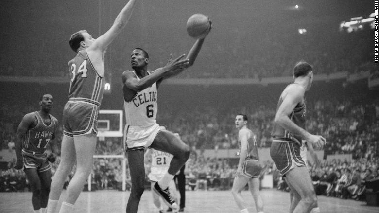 Boston Celtics player Bill Russell during a 1960 NBA Championship game against the Saint Louis Hawks.