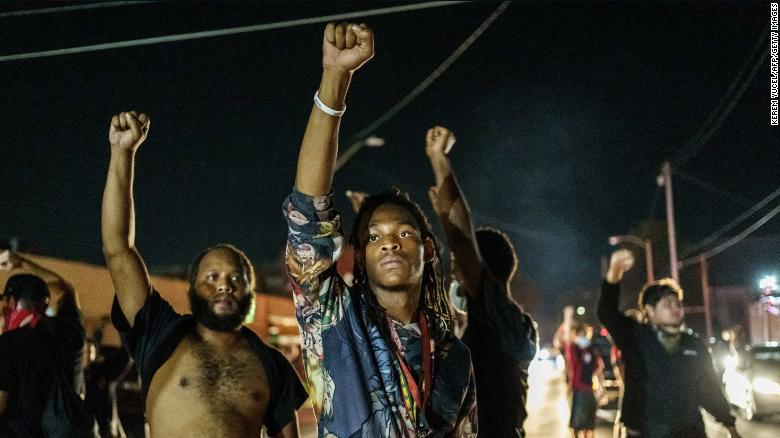 Protesters raise their fists during a demonstration in Kenosha, Wisconsin, on Wednesday, August 26.