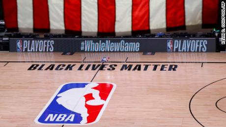 An empty court and bench are shown following the scheduled start time of Game 5 of an NBA first-round playoff series.