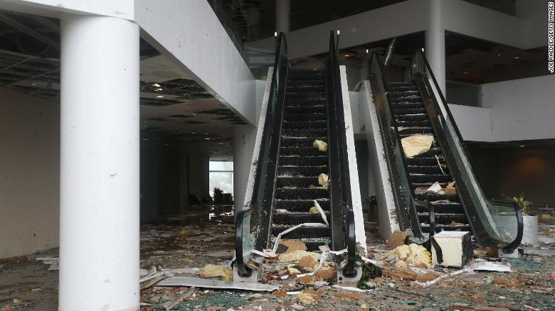 Debris is strewn down an escalator in Capitol One Bank Tower on Thursday in Lake Charles.