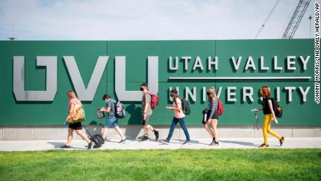 Utah Valley University students walk to campus after being dropped off by the UVX bus in Orem, Utah, on Monday, August 24, 2020.