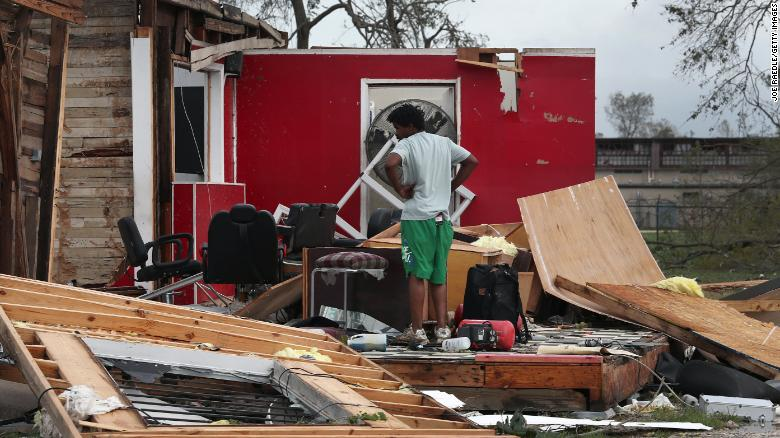 James Sonya surveys what is left of his uncle's barber shop Thursday in Lake Charles, Louisiana.