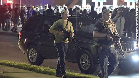 Kyle Rittenhouse, left, with backwards cap, is shown Tuesday, the night of the shooting, in Kenosha, Wisconsin.