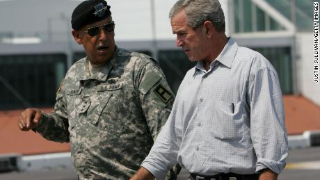 Lt. Gen. Russel Honoré talks with then-President George W. Bush in New Orleans, three weeks after Hurricane Katrina, as Hurricane Rita was threatening the same area.