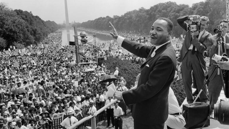 Martin Luther King waves to supporters during the 1963 March on Washington.