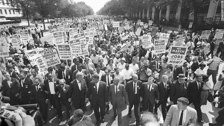 Dr. Martin Luther King Jr, third from left, and other civil right leaders lead the 1963 March on Washington.