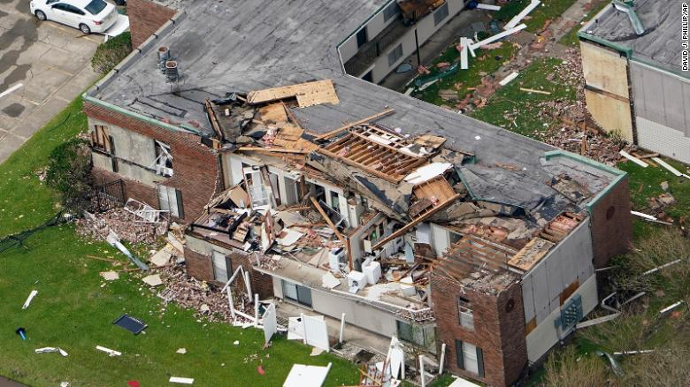 An apartment building is damaged Thursday after Hurricane Laura went through the area near Lake Charles, La.