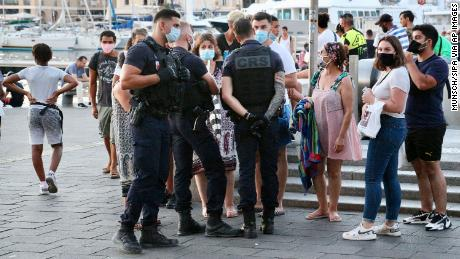 Police are now enforcing the wearing of masks in cities such as Marseille to slow rising Covid infections.