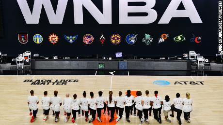 The Washington Mystics each wear white T-shirts with seven bullet holes on the back at Feld Entertainment Center on August 26, 2020 in Palmetto, Florida, as they protest the shooting of Jacob Blake by Kenosha, Wisconsin police