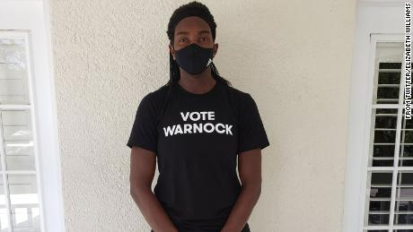 "Elizabeth Williams wearing a ""Vote Warnock"" shirt. Many members of the Atlanta Dream, as well as players from other teams, have worn the shirts to support Raphael Warnock's US Senate campaign in Georgia."