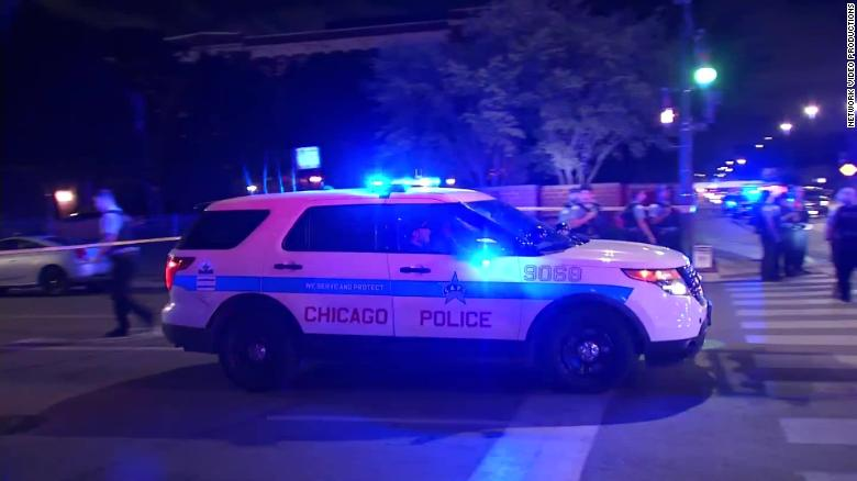 Chicago police respond after reports that two officers were injured by gunfire Sunday.