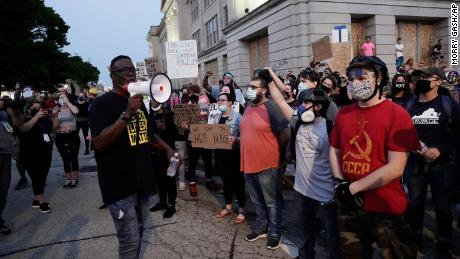 People gather Tuesday, August 25 to protest in Kenosha, Wisconsin. Anger over the Sunday shooting of Jacob Blake, a Black man, by police spilled into the streets for a third night.