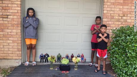"Kian and his siblings strike ""Wakanda Forever"" poses during a memorial for Chadwick Boseman."