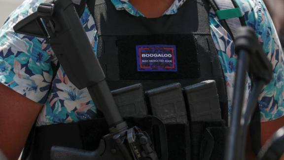 An armed protester wearing a Hawaiian shirt and a Boogaloo badge takes part in a rally for Second Amendment gun rights near the Virginia State Capitol in Richmond, Virginia, U.S., July 4, 2020. REUTERS/Jonathan Ernst