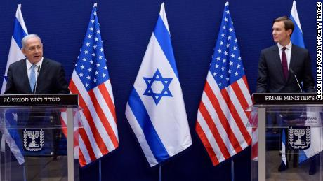 Israeli Prime Minister Benjamin Netanyahu, left, and Kushner make joint statements to the press in Jerusalem on Sunday ahead of Monday's historic flight.