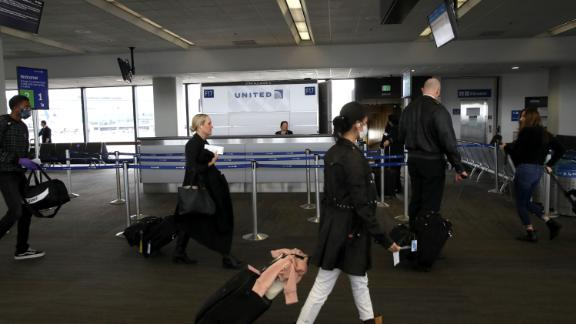 SAN FRANCISCO, CALIFORNIA - APRIL 12: Passengers practice social distancing as they prepare to board a United Airlines flight to Los Angeles at San Francisco International Airport on April 12, 2020 in San Francisco, California. San Francisco International Airport has a seen a huge decline in daily flights since the coronavirus shelter in place. United Airlines, the airport