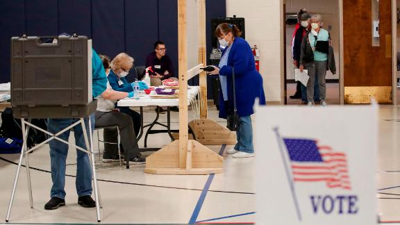 A woman checks in to cast her ballot during a Democratic presidential primary election at the Kenosha Bible Church gym in Kenosha, Wisconsin, on April 7, 2020. - Americans in Wisconsin began casting ballots Tuesday in a controversial presidential primary held despite a state-wide stay-at-home order and concern that the election could expose thousands of voters and poll workers to the coronavirus. Democratic officials had sought to postpone the election but were overruled by the top state court, and the US Supreme Court stepped in to bar an extension of voting by mail that would have allowed more people to cast ballots without going to polling stations. Both courts have conservative majorities. (Photo by KAMIL KRZACZYNSKI / AFP) (Photo by KAMIL KRZACZYNSKI/AFP via Getty Images)