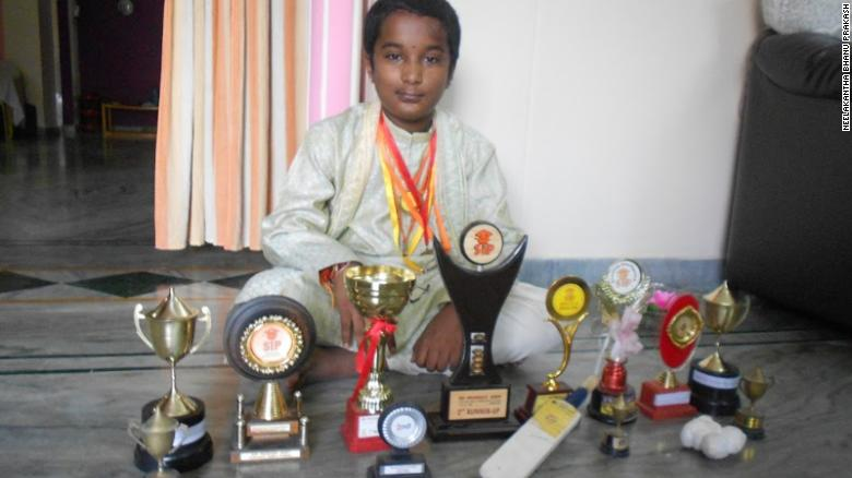 Bhanu, aged 10, poses with his haul of math tournament trophies in 2010.