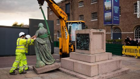 A statue of slave trader Robert Milligan is removed near the Museum of London Docklands in June.