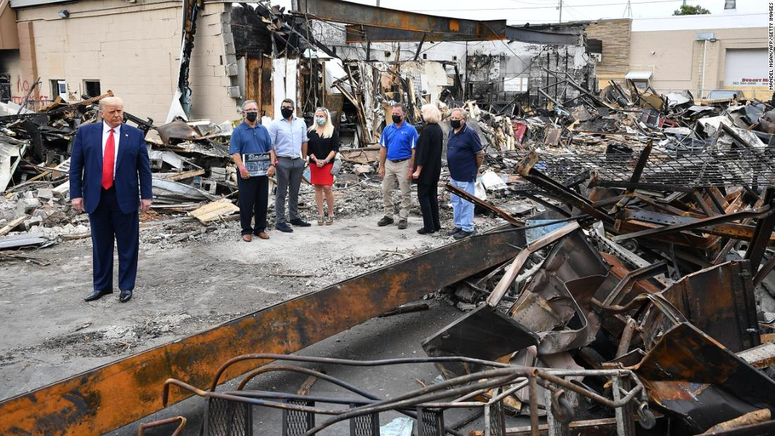 Trump tours a building that was damaged during the protests in Kenosha.