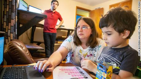 Kara Vaughn is helping her son Simon, a kindergarten teacher, prepare for Zoom class on July 30, 2020 at her home in Urbandale, Iowa.