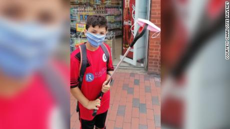 Jojo Eisawy, 9, shows off the discarded face mask found on his litter pick up.