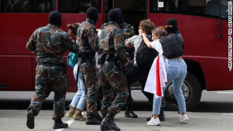 Security officials took students into custody during an anti-Lukashenko protest in Minsk on Tuesday.