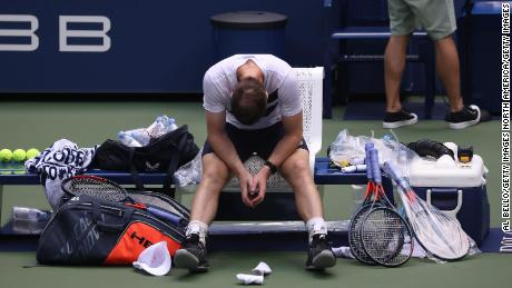 Andy Murray sits in his chair after seeing off Yoshihito Nishioka at the US Open.
