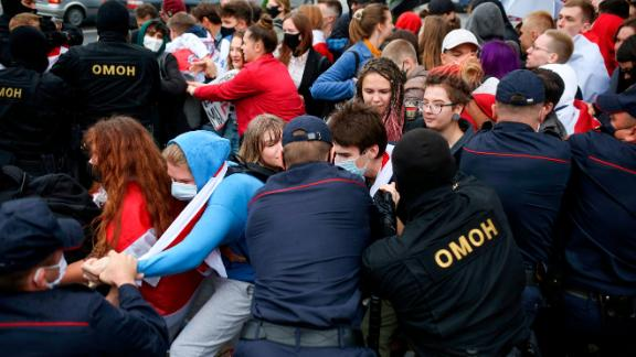 Police detain students during a protest in Minsk, Belarus, Tuesday, Sept. 1, 2020. Several hundred students on Tuesday gathered in Minsk and marched through the city center, demanding the resignation of the country's authoritarian leader after an election the opposition denounced as rigged. Many have been detained as police moved to break up the crowds. (Tut.By via AP)