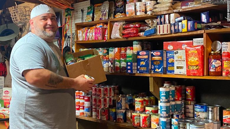 An out-of-work chef has turned his garage into a food pantry that defies convention