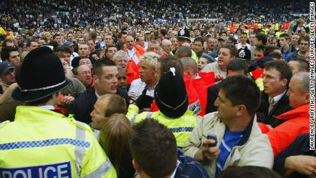Local hero and Leeds United striker Alan Smith (center) is mobbed as thousands invade the pitch at Elland Road following the club's 2004 relegation.