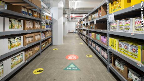 Whole Foods' new online-only store allows workers inside to pick items off shelves and deliver them to customers in the Brooklyn area.
