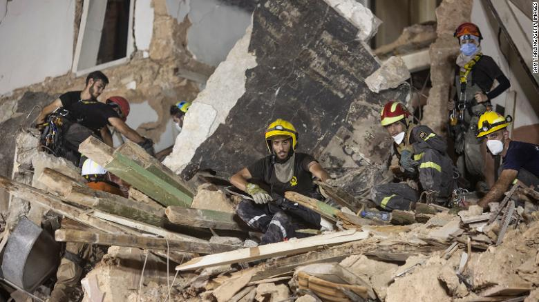 Rescue workers clear rubble from a destroyed building in the hope of finding a potential survivor in the aftermath of the Beirut blast on September 4, 2020.