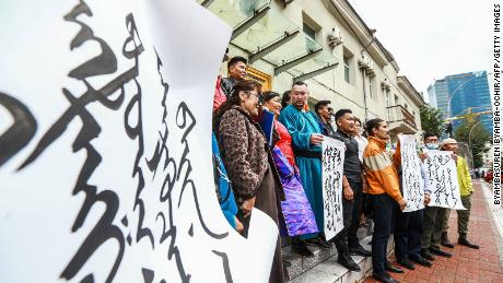 Mongolian citizens protest at the Ministry of Foreign Affairs in Ulaanbaatar, the capital of Mongolia, against China's plan to reduce teaching in Mongolian at schools in the neighboring Chinese region of Inner Mongolia on August 31, 2020.