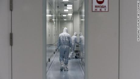 Employees walk on May 20 in a passage at the headquarters of Russia's biotech company BIOCAD, which has been working on a vaccine against the coronavirus.