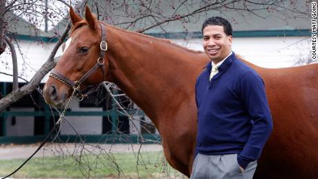 Greg Harbut, who owns a horse competing in Saturday's Kentucky Derby, poses with Grade 1 winner Tell a Kelly.