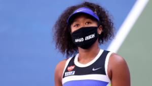 NEW YORK, NEW YORK - SEPTEMBER 04: Naomi Osaka of Japan wears a protective face mask with the name, Ahmaud Arbery stenciled on it after winning her Women's Singles third round match against Marta Kostyuk of the Ukraine on Day Five of the 2020 US Open at USTA Billie Jean King National Tennis Center on September 04, 2020 in the Queens borough of New York City. Ahmaud Arbery, was an unarmed 25-year-old African-American man, was pursued and fatally shot while jogging in Glynn County, Georgia. (Photo by Al Bello/Getty Images)
