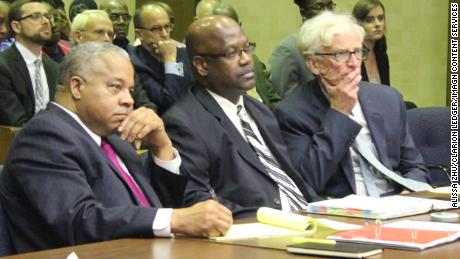 Curtis Flowers, center, sits with his attorneys, Henderson Hill, left, and Rob McDuff during a December 2019 bond hearing in Winona, Mississippi.