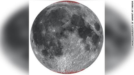 Un mapa mejorado de hematita (polvo) en la luna, mostrado en rojo usando una proyección esférica en el lado cercano.