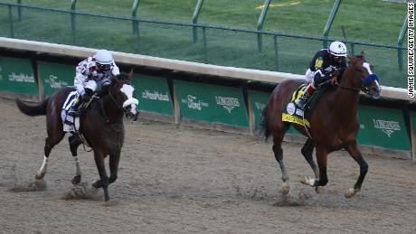 Authentic, right, ridden by jockey John Velazquez, leads down the stretch to defeat Tiz the Law at the Kentucky Derby on Saturday, September 5, 2020.