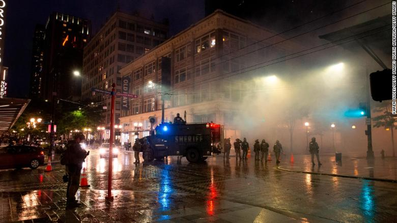 Man charged with stealing a police gun during Seattle protests identified with the help of a YouTube video