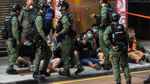 Police detain people protesters called for a rally in Hong Kong on September 6