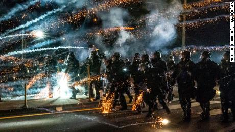 Police said protesters threw fire bombs, fireworks and mortars at officers, which lead authorities to declare the march a riot and ordered people to leave the area.